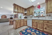 7-Open-kitchen-to-breakfast-bar-and-dining-room