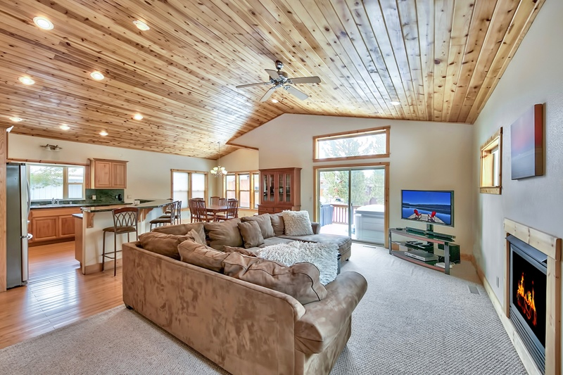 Great Room With Towering Knotty Pine Ceiling